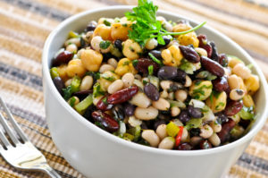 Vegeterian salad of various beans in bowl close up